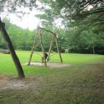 Playground includes 4 swings and a sandbox