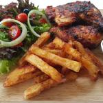 Ann's Kitchen Bar & Grill. Flame grilled Piri Piri chicken, Handcut, home made chips and salad