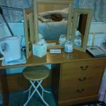 The height of the dressing table, relative to the kettle