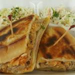 Our famous Hawbano Sandwich!  Kalua Pork with Kim Chee Slaw, Swiss Cheese, Ham, Pickles and Must