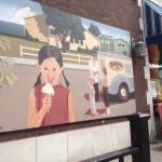 View of the mural from an outdoor seating area.