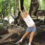 Granddaughtr Bonnie swinging from a fig tree root