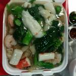 Seafood with fried rice noodle ($7.00), well pan charred noodles with fresh seafood. Starchy gra