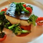 Kingfish with a chorizo puree, charred broccoli, and cherry tomatoes.