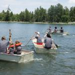 Family reunion rowing contest on the lake
