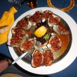 a dozen Oysters Kilpatrick