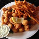 Fried bay scallops with homemade tartar sauce and hand-cut sweet potato fries.