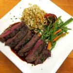 VENISON Marinated and grilled red deer served with lingonberry demi-glace and German spätzle