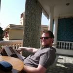 Reading the paper on the veranda