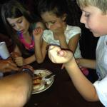 Kids enjoying a sopapilla.