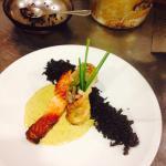 Sweet chilli glazed salmon on Thai sauce with wild rice & homemade salmon, king prawn spring rol