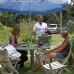 convivial moment:guests meeting in the garden