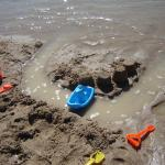 Kids had fun with their boats shovels and pails