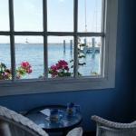 Enjoy a beautiful view of the harbor while sipping fresh coffee and rocking in some wicker chair