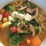 Cargo noodle bowl with udon noodles and tom yum broth