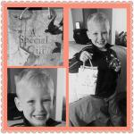 Grandson in our room holding up gift for his mommy.