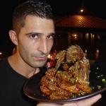 Stefan with his delicious fried snapper and refusing to share it with anyone.