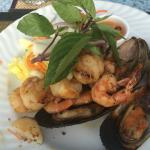 Grilled scallops, shrimp, and mussels.