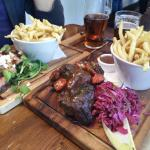 To the right - Beef ribs with red cabbage (special menu).  On the left -  char grilled skirt ste