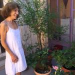 Aida the owner in her patio garden