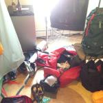 After packrafting trip/Organizing gear in small space. Bunk beds to left.