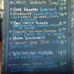 Black board menu with at least 3 new specials.  Onion soup grantinee, beef & salmon burgers R