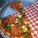 Gluten free crust with spinach, tomatoes, and feta and mozzarella cheeses. We had the remainder