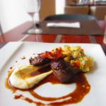 Confited pork cheeks with parsnip purée and demi-glace