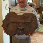 Owner with one of his carvings made from the volcanic Rock