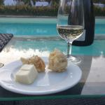 Prosecco and cheese by the pool