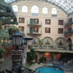 View of pool, hotel and skylight from restaurant entrance