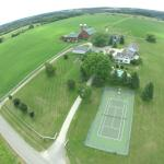 Aerial View of Main Entrance, Tennis Court and Pool