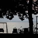 The swing and chairs and the lake /sunset facing view