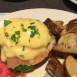 EMPIRE EGGS: Two poached eggs, spinach, smoked salmon on potato pancakes, hollandaise.