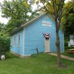 A baby blue schoolhouse
