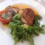 Duck with orange sauce and tomato stuffed with blue cheese