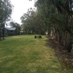 Lawned area beside the river with tables and seating and a wonderful fire-pit