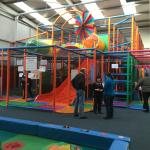 Main play area with glimpse of toddler in the foreground.