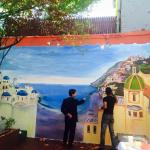 Talented artist Jaleel Akaloo finalizing his mural