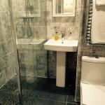 Beautifully decorated Bathroom with Large Shower