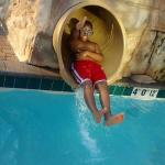 My son coming down the water slide.