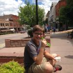 Son enjoying the yellowcake ice cream in front of shop. Delicious, and great people watching!
