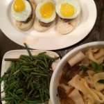Quail Egg-Chinese sausage on toasted bao, pork belly noodles, fern salad