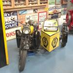 A.A. Motorbike and sidecar.
