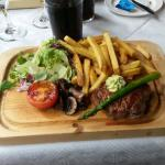 Steak on a plank by restaurant Wanha Mylly