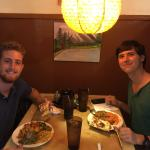 Two travelers from Seville, Spain, enjoying their first taste of Nepalese food.