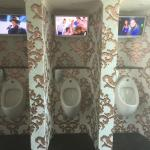 The amazing tiled urinals with TV!