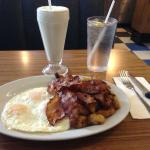 Bacon and eggs breakfast with milkshake.