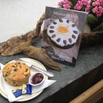 Abraham's Cafe recipe book and traditional scone with jam