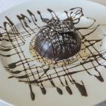 Chocolate mound with raspberry sauce filling